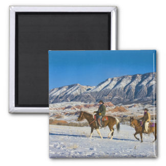 Cowboy and Cowgirl riding Horse through the Snow Fridge Magnet
