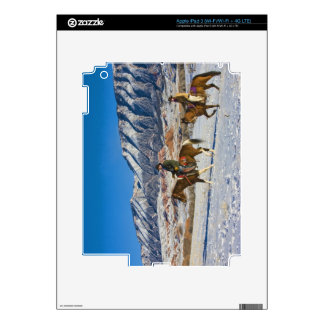 Cowboy and Cowgirl riding Horse through the Snow iPad 3 Skin