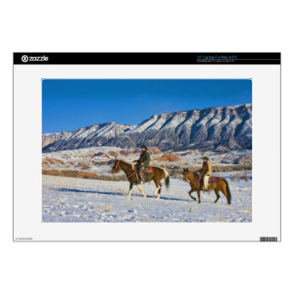 Cowboy and Cowgirl riding Horse through the Snow Skin For Laptop