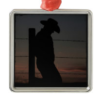 Cowboy at sunset metal ornament