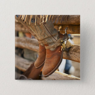 Cowboy boots on fence 2 button