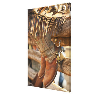 Cowboy boots on fence 2 canvas print