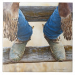 Cowboy boots on fence ceramic tile