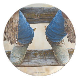 Cowboy boots on fence dinner plate