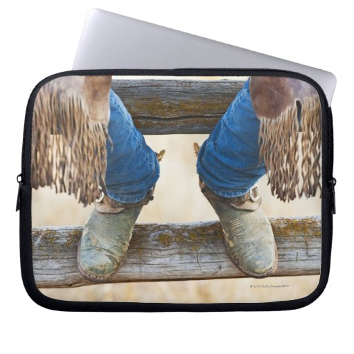 Cowboy boots on fence laptop computer sleeves