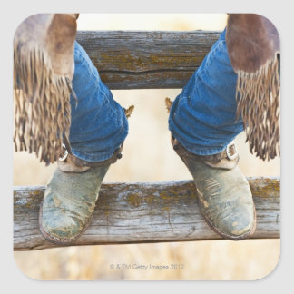 Cowboy boots on fence square sticker