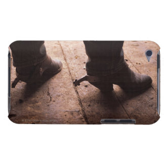 Cowboy boots with spurs on boardwalk at iPod touch case