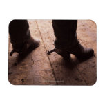 Cowboy boots with spurs on boardwalk at vinyl magnet