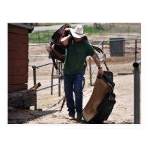 Cowboy Carrying a Saddle Postcard