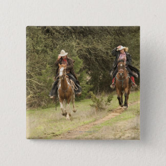 Cowboy couple riding horses pinback button