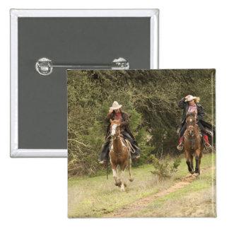 Cowboy couple riding horses pinback button