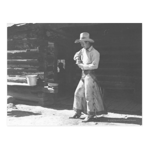 Cowboy eating from a Peter Pan peanutbutter can. Postcard