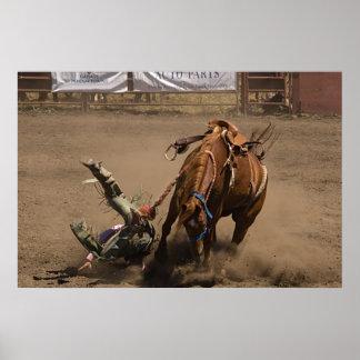 Cowboy falls from bucking bronc poster