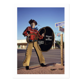 Cowboy figure sign welcoming tourists to Scottsdal Postcard
