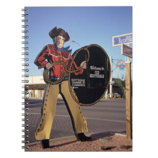 Cowboy figure sign welcoming tourists to Scottsdal Spiral Notebook