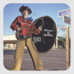 Cowboy figure sign welcoming tourists to Scottsdal Square Sticker