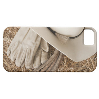 Cowboy hat gloves and rope on haystack iPhone 5 cover