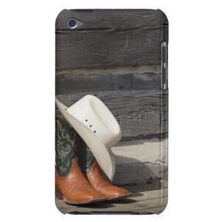 Cowboy hat on cowboy boots outside a log cabin barely there iPod cover