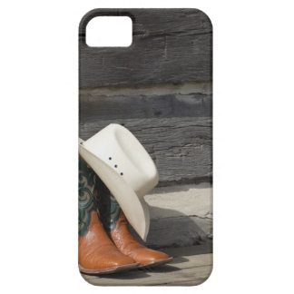 Cowboy hat on cowboy boots outside a log cabin iPhone 5 cover