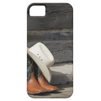 Cowboy hat on cowboy boots outside a log cabin iPhone SE/5/5s case