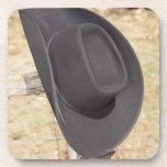 Cowboy hat on fence beverage coasters