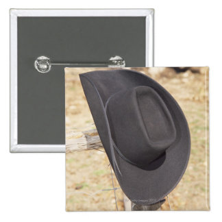 Cowboy hat on fence buttons