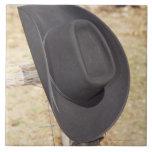 Cowboy hat on fence large square tile