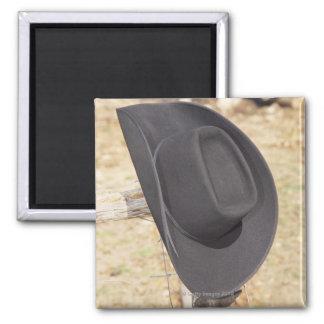 Cowboy hat on fence fridge magnet