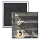 Cowboy hat on guitar leaning on log cabin 2 inch square magnet