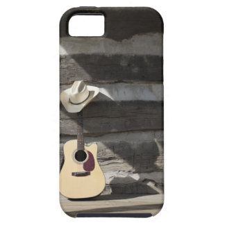 Cowboy hat on guitar leaning on log cabin iPhone SE/5/5s case