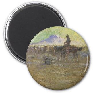 Cowboy Herding Cattle on the Range by Lon Megargee Magnet