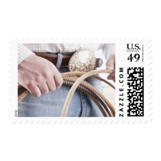 Cowboy holding a rope stamp