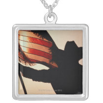 Cowboy holding Stars and Stripes, silhouette, Silver Plated Necklace
