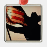 Cowboy holding Stars and Stripes, silhouette, Square Metal Christmas Ornament