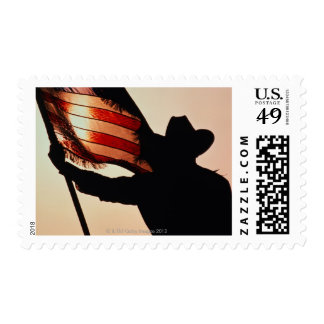 Cowboy holding Stars and Stripes, silhouette, Stamp
