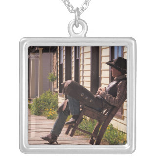 Cowboy in chair on boardwalk in South Park City, Silver Plated Necklace