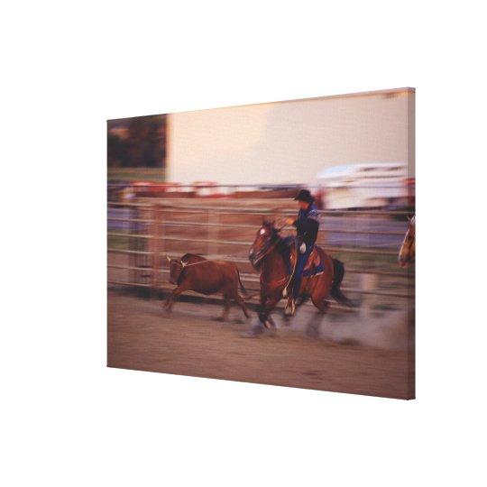 Cowboy lassoing bull canvas print