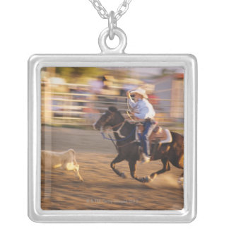 Cowboy lassoing calf silver plated necklace