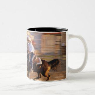 Cowboy lassoing calf Two-Tone coffee mug