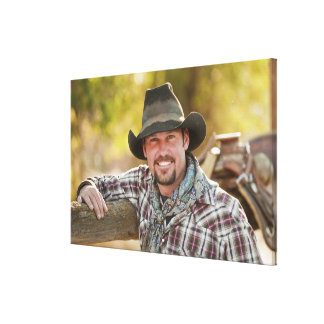 Cowboy leaning on fence canvas print