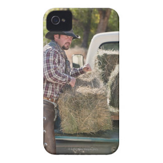 Cowboy lifting bales of hay Case-Mate iPhone 4 case