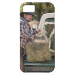 Cowboy lifting bales of hay iPhone 5 case