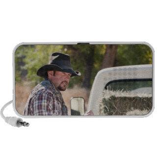 Cowboy lifting bales of hay iPhone speakers
