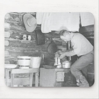 Cowboy making coffee inside the bunkhouse mouse pad