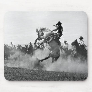 Cowboy on a bucking bronco mouse pad