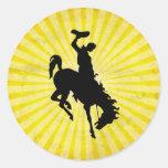 Cowboy on Bucking Bronc; yellow Classic Round Sticker