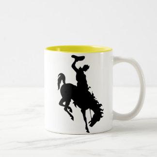 Cowboy on Bucking Bronc; yellow Two-Tone Coffee Mug