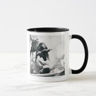 Cowboy on ground after falling off bull mug