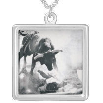 Cowboy on ground after falling off bull silver plated necklace