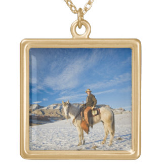 Cowboy on his Horse in the Snow 2 Gold Plated Necklace
